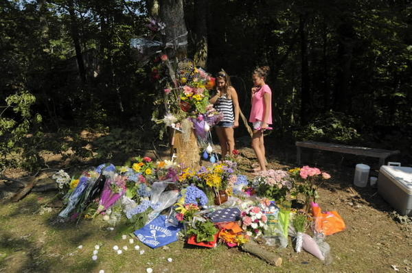 Friends gather at the crash site in July where Glastonbury High School senior Jane Modlesky was killed.