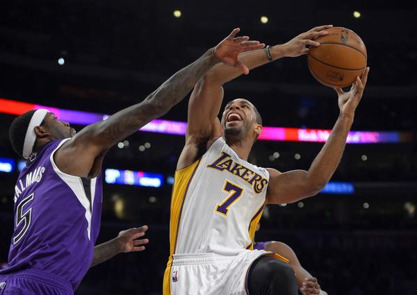 Forward Xavier Henry (7) shoots over Sacramento Kings forward John Salmons during the first half of the Lakers' 100-86 victory in November.