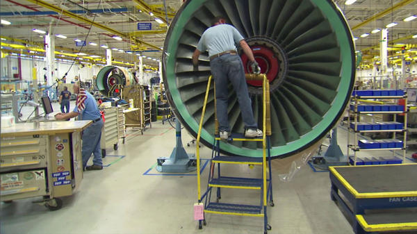 Pratt & Whitney machinists work on one of the company's factory floors.