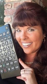 Gay Lynn Grigas holds up a giant remote which he uses in her anti-bullying programs at Broward schools and for workplace self-empowerment seminars at local companies.