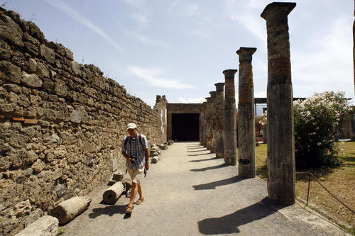 A visitor walks in Pompeii, the famous city next to Naples which was destroyed in AD 79 by the eruption of Mount Vesuvius July 17, 2008.
