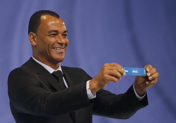 "Former Brazilian soccer player Cafu holds the slip showing ""Brazil' during the draw for the 2014 World Cup at the Costa do Sauipe resort in Sao Joao da Mata, Bahia state, December 6, 2013. The 2014 World Cup finals will be held in Brazil from June 12 through July 13."