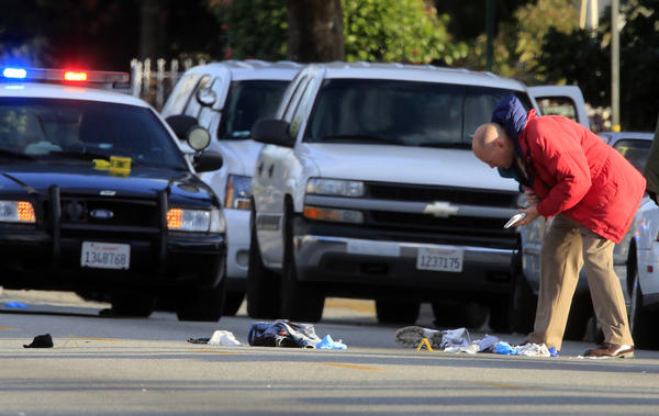 Investigators gather evidence at the scene of an officer-involved shooting in the 3500 block of Cogswell in El Monte.
