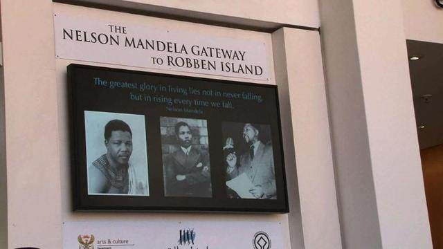 Tourists headed for Robben Island pay tribute to Mandela