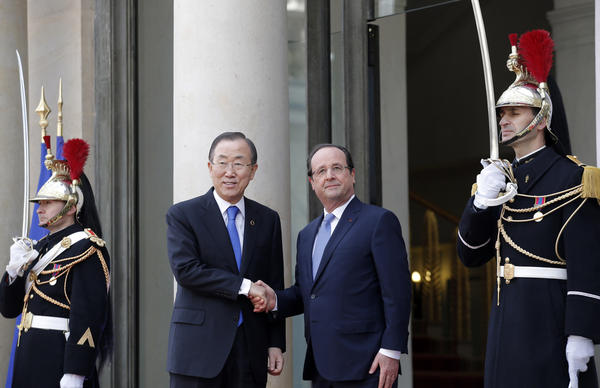 U.N. Secretary-General Ban Ki-moon, center left, is greeted by French President Francois Hollande at the Elysee Palace, in Paris.