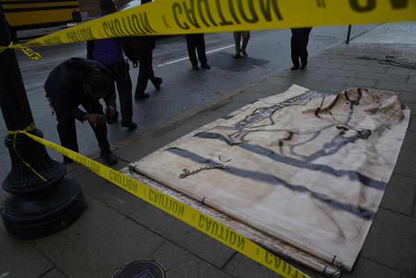 A banner fell at the Walters museum Friday, shattering a window.