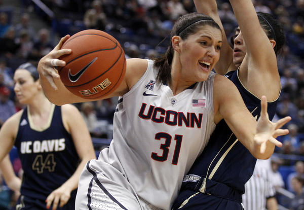 Huskies center Stefanie Dolson drives the ball Thursday in UConn's 97-37 win over UC Davis.