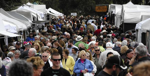 Crowds jam downtown Mount Dora for the 35th annual Mount Dora Arts Festival, sponsored by the Mount Dora Center for the Arts, Saturday , Feb. 6, 2010.