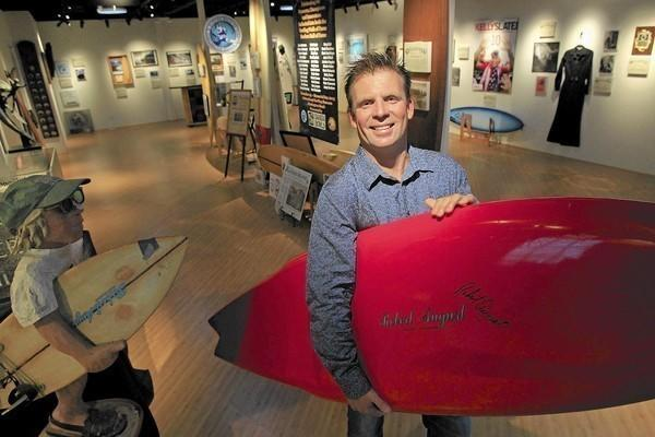Paul Taylor, business administrator for the board of directors, poses for a portrait at the newly remodeled International Surfing Museum in Huntington Beach on Tuesday.