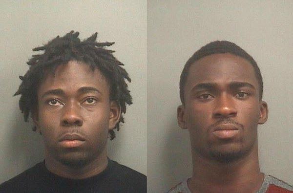 From left, Akensvil Paulvil, 21, and Licence Sineas, 19, both of Boynton Beach, are accused of leaving Walmart with stolen electronics, then coming back shortly after to steal two TVs.