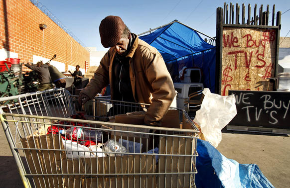 A man who goes by the name Double O sorts items he collected to recycle at West Coast Recycling at Towne Avenue and East 4th Street in downtown Los Angeles. Double O complained about a state law that took effect Nov. 1 reducing how much money he can get for wine, liquor an