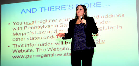 Anna-Kristie Marks, a deputy district attorney in Lehigh County, talks about the dangers of sexting and digital crime to students at Orefield Middle School Friday.  A Berks county lawmaker is calling for criminal penalties for people who post naked photos of others online.
