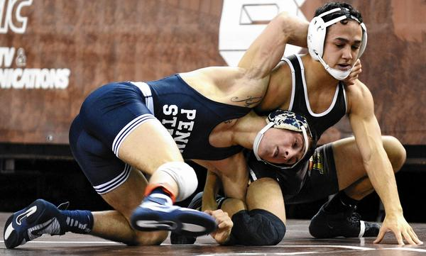 Lehigh's Darian Cruz (right) wrestles Penn State's Nico Megaludis in an early season match at Stabler Arena.
