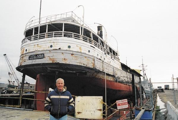 Author David C. Henley stands in front of the SS Wapaha, a 99-year-old coastal cargo and passenger steamer that called into Newport Beach from 1916 to the early 1930s.