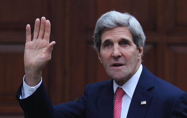 Secretary of State John Kerry, waves as he arrives to the West Bank town of Ramallah for a meeting with the Palestinian President Mahmoud Abbas.