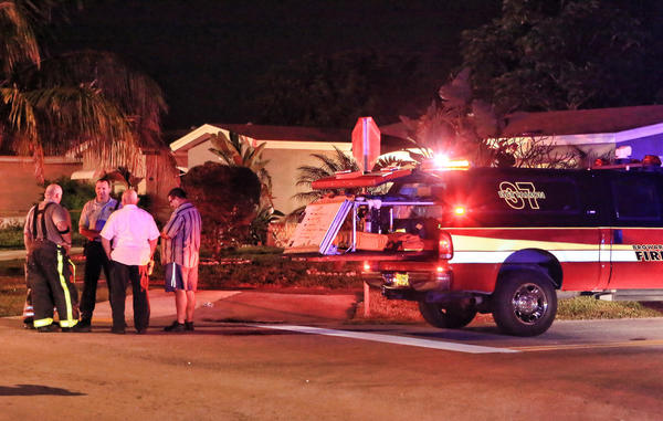 Broward County Sheriff Fire Rescue at the scene at a house fire located at 5061 NW 41 St in Lauderdale Lakes.