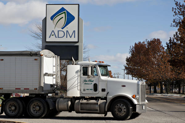 A grain truck exits the campus of the Archer-Daniels-Midland Co. (ADM) headquarters and the Decatur Corn Plant in Decatur, Illinois, U.S., on Tuesday, Nov. 12, 2013. Archer-Daniels-Midland Co. procures, transports, stores, processes, and merchandises agricultural commodities and products as well as processes oilseeds, corn, milo, oats, barley, peanuts, and wheat.