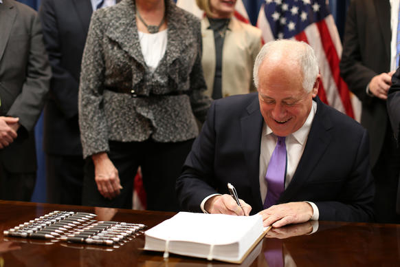 captions pension reform gov pat quinn signs the pension reform bill