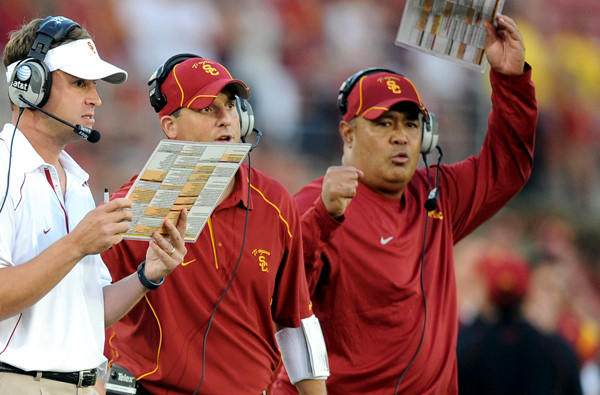 Kennedy Polamalu, right, was a key part of the staff for former USC coach Lane Kiffin, left.