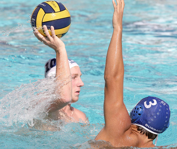 Flintridge Preps' John Treinen passes the ball as Burbank's Gevork Terzyan defends during a non-league match on Tuesday, September 17, 2013.