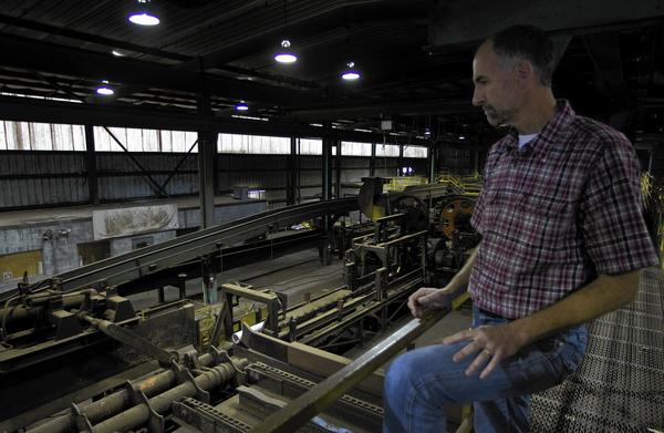 Terry Godwin, co-owner of Franklin Lumber, looks over one of the cutters on the floor of the sawmill in Isle of Wight County.