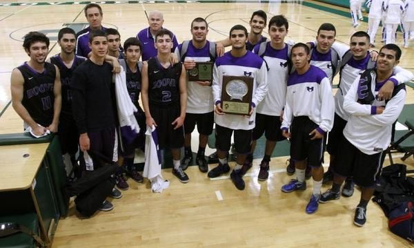 The Hoover High boys' basketball team took home two plaques after winning Saturday afternoon's consolation championship of the Providence High Paul Sutton Tip-Off Classic Invitational in Burbank on Saturday. (Raul Roa/Staff Photographer)