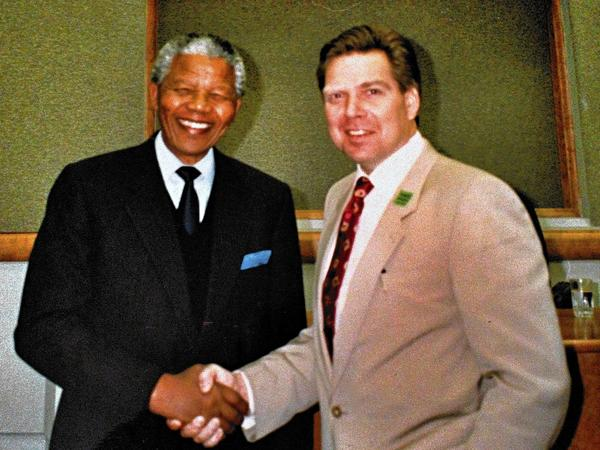 Charles McLean shakes hands with Nelson Mandela in South Africa about a month after Mandela was released from prison on Feb. 11, 1990.