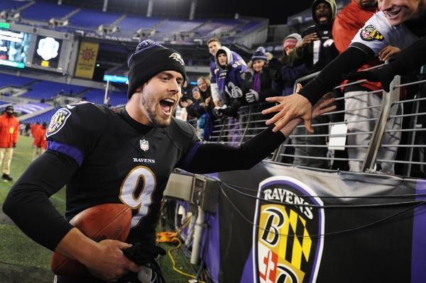 Kicker Justin Tucker celebrates with fans after a 22-20 win over the Steelers at M&T Bank Stadium last month.