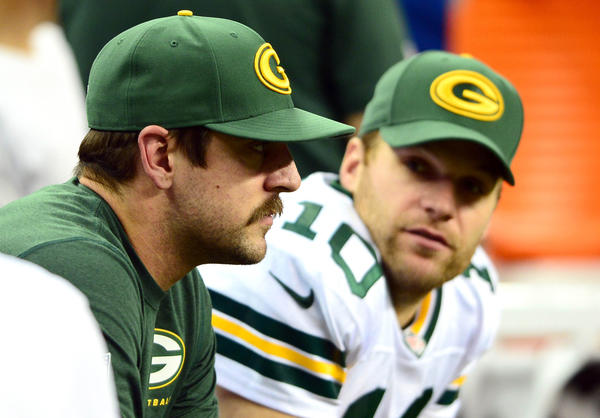 Green Bay Packers quarterback Aaron Rodgers (left) sits next to quarterback Matt Flynn (10)during a game last month.