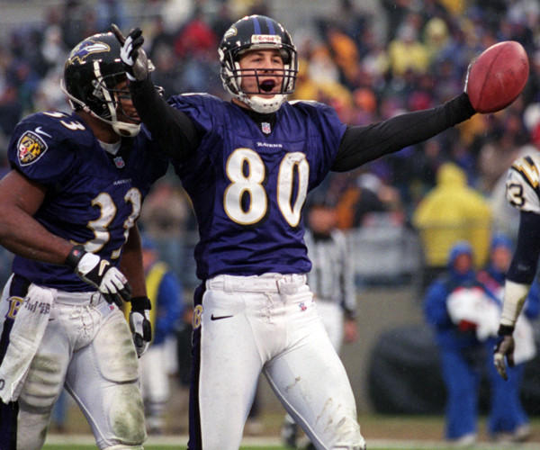 The Ravens defeated San Diego, 24-3, at PSINet Stadium to clinch a postseason berth for the first time. Trent Dilfer threw touchdown passes to Brandon Stokley, pictured, and Qadry Ismail.