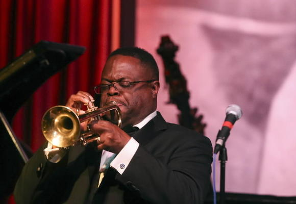 Orbert Davis, performs with the Columbia College Jazz Ensemble during a celebration of William Russo, at the Jazz Showcase on Saturday.