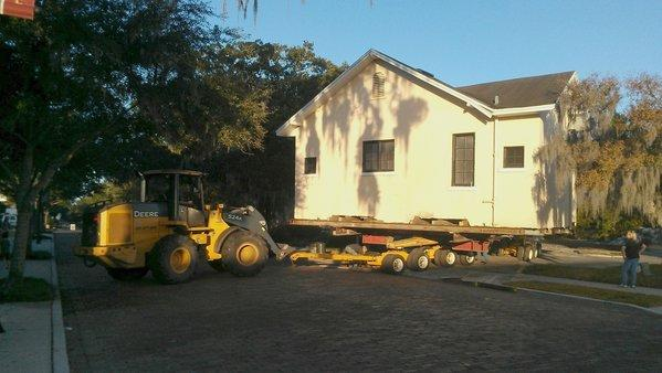 The Winter Park Wedding Chapel is towed off its West New England Avenue lot en route to a new home Sunday morning.