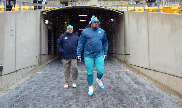 Paul Soliai heads to the field to warm-up befor ethe game against Pittsburgh. Miami Dolphins vs. Pittsburgh Steelers. Heinz Field, Pittsburgh, PA. 12/8/13. Jim Rassol, Sun Sentinel.