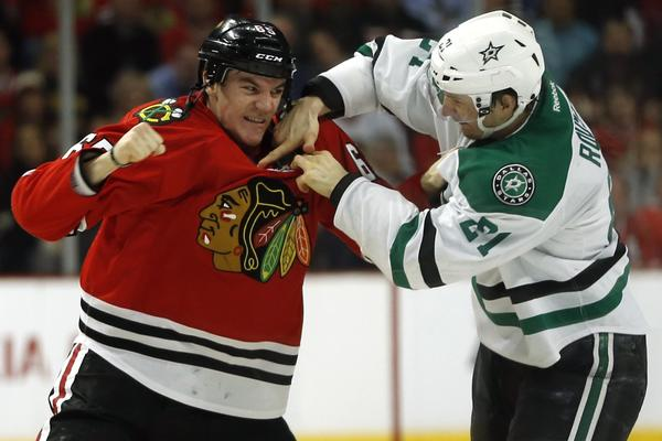 Chicago Blackhawks' Andrew Shaw, left, fights the Dallas Stars' Antoine Roussel in the first period at United Center last week.