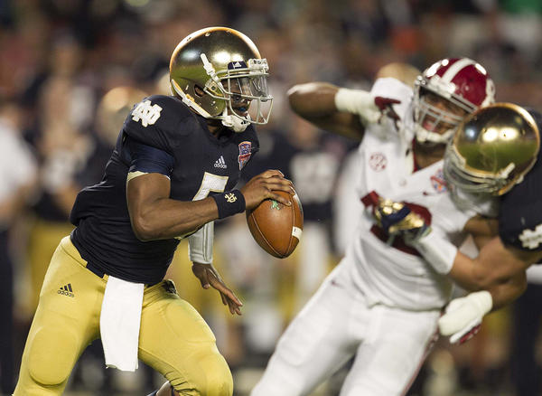 Notre Dame quarterback Everett Golson (5) scrambles out of the pocket against Alabama in the BCS National Championship game.