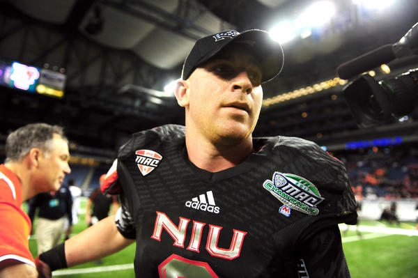 Northern Illinois Huskies quarterback Jordan Lynch (6) leaves the field after being defeated by Bowling Green Falcons 47-27 at Ford Field.