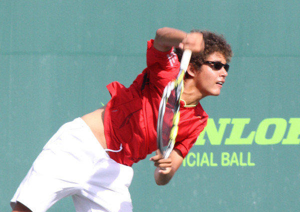 Ulises Blanch of the U.S. serves on the way to winning his first-round of the Boys 16s at the Orange Bowl International Tennis Championships in Plantation.