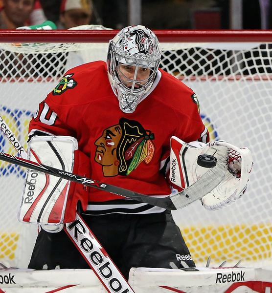 Hawks goalie Corey Crawford was injured during Sunday's game against the Panthers.