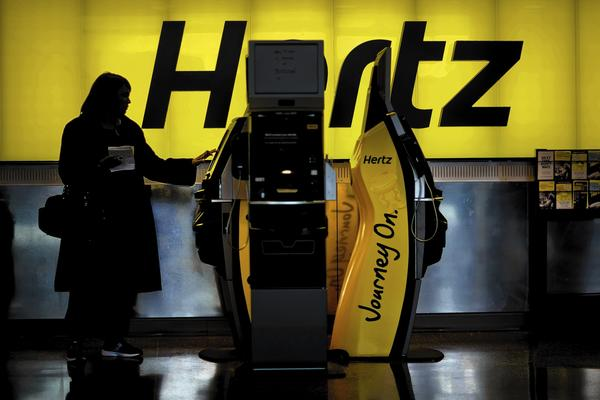 Hertz has begun to use a biodegradable spray solution that is wiped off with microfiber towels at 220 locations across the country. Next year, Hertz hopes to expand the program to all 3,700 locations in the U.S. and Europe, saving more than 130 million gallons of water annually. Above, a Hertz rental counter at Hartsfield-Jackson Atlanta International Airport last month in Atlanta.