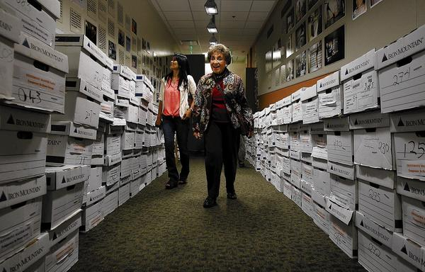 Lotte Hoffman, 91, center, along with her caregiver Joy Hinlo, left, visits the USC Shoah Foundation's video post-production and transfer room at USC to see how testimonies like her own are restored and preserved and used to teach people all over the world about the Holocaust.