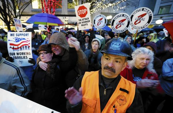 Union workers and supporters hold a rally last month in Seattle calling for Boeing to build its 777X airliner in Washington. The aerospace giant is considering other locations.
