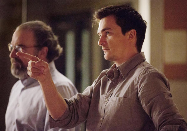 "CIA Acting Director Saul Berenson (Mandy Patinkin) and CIA operative Peter Quinn (Rupert Friend) monitor a mission in Iran on ""Homeland."""