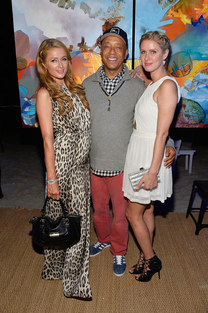MIAMI BEACH, FL - DECEMBER 06:  (L-R) Paris Hilton, Russell Simmons and Nicky Hilton attend the Bombay Sapphire artisan series finale dinner hosted by Russell Simmons and Tom Colicchio at Soho Beach House on December 6, 2013 in Miami Beach, Florida.