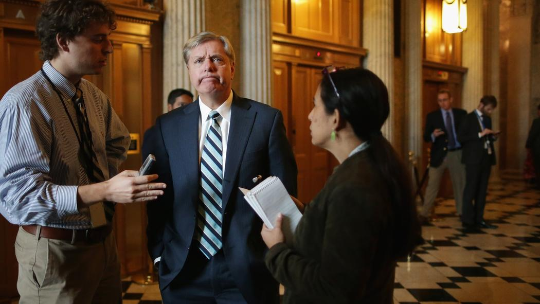 Sen. Lindsey Graham (R-S.C.) talks with reporters before attending the weekly Senate Republican Caucus policy luncheon at the Capitol. (Chip Somodevilla / Getty Images)