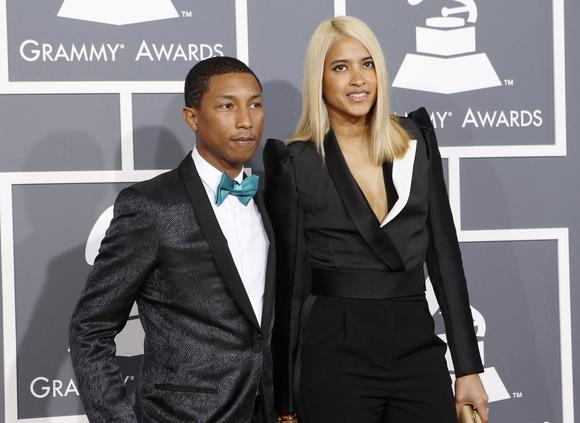 Rapper and record producer Pharrell Williams and girlfriend Helen Lasichanh arrive at the 55th annual Grammy Awards in Los Angeles