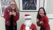 Sandburg Debate spreads holiday cheer, brings home trophies