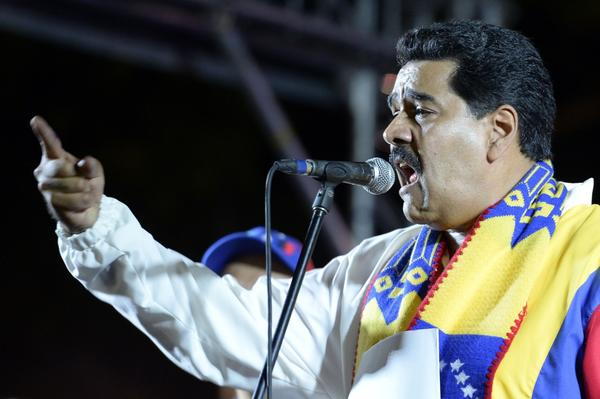 Venezuelan President Nicolas Maduro gives a speech after the first official results from municipal elections were announced in Caracas.