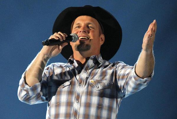Garth Brooks sings at the 48th ACM Awards in Las Vegas on April 7, 2013. He announced he will return next year on a world tour.