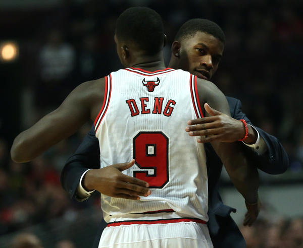 Chicago Bulls small forward Luol Deng gets a hug from injured teammate Jimmy Butler before a game against the Miami Heat at the United Center