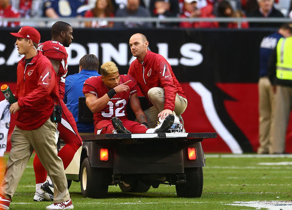 Tyrann Mathieu reacts as he is taken off the field after suffering an injury in the third quarter against the St. Louis Rams.